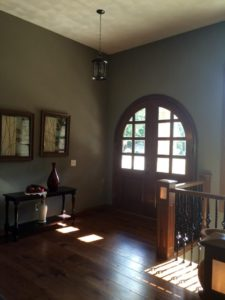 foyer with painted walls and sand swirl plaster ceiling